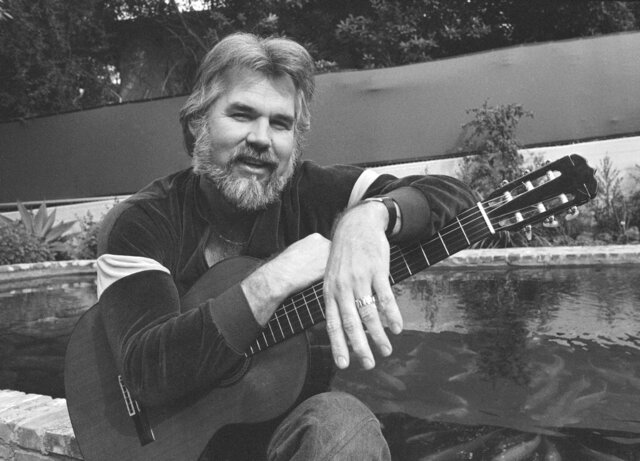 "FILE - This Feb. 20, 1978 file photo shows Kenny Rogers at his home in Brentwood, Calif.   Rogers, who embodied ""The Gambler"" persona and whose musical career spanned jazz, folk, country and pop, has died at 81. A representative says Rogers died at home in Georgia on Friday, March 20, 2020.  (AP Photo/Wally Fong, File)"
