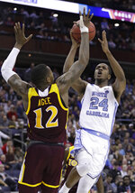 North Carolina's Kenny Williams (24) shoots over Iona's Tajuan Agee (12) in the first half during a first round men's college basketball game in the NCAA Tournament in Columbus, Ohio, Friday, March 22, 2019. (AP Photo/Tony Dejak)