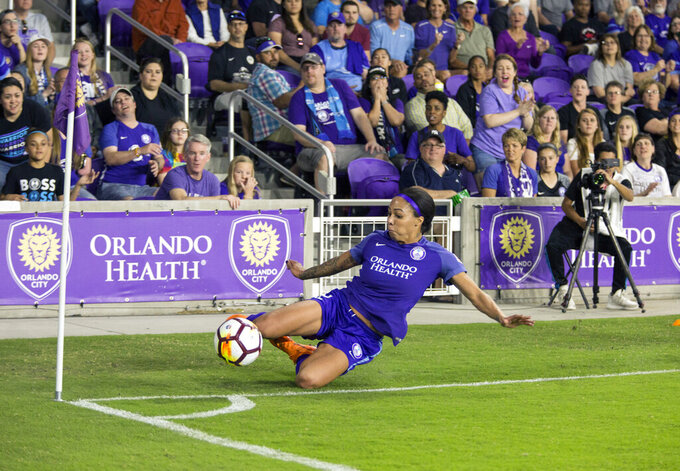 FILE - In this Saturday, March 24, 2018 file photo, Orlando Prides Sydney Leroux keeps the ball in play during a National Women's Soccer League match at Orlando City Stadium in Orlando, Fla. Sydney Leroux simply isn't done chasing her soccer dreams. The veteran forward signed a 3-year max deal with the Orlando Pride, the National Women's Soccer League team she's been with since 2018. Announced Wednesday, Feb. 3, 2021 the contract has an option for an additional year. (Justin Green/Orlando Sentinel via AP, File)