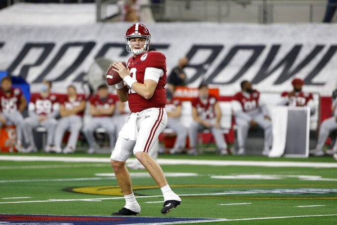 Alabama quarterback Mac Jones (10) warms up before the start of their Rose Bowl NCAA college football game against Notre Dame in Arlington, Texas, Friday, Jan. 1, 2021. (AP Photo/Michael Ainsworth)
