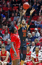 Southern California forward J'Raan Brooks (33) shoots as Utah forward Donnie Tillman, left, defends in the first half during an NCAA college basketball game Thursday, March 7, 2019, in Salt Lake City. (AP Photo/Rick Bowmer)