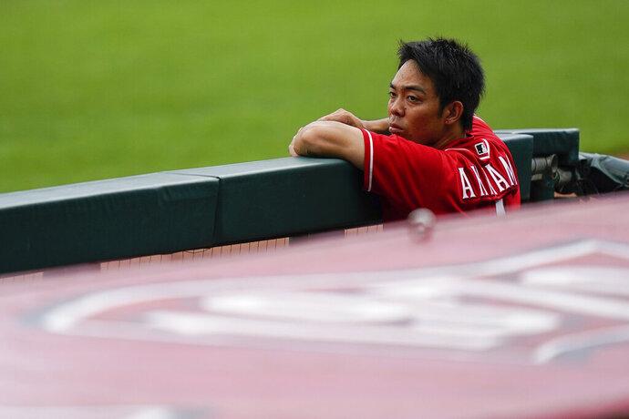 Cincinnati Reds center fielder Shogo Akiyama watches team baseball practice from the dugout at Great American Ballpark in Cincinnati, Friday, July 10, 2020. (AP Photo/Bryan Woolston)