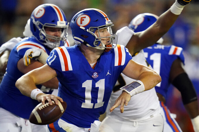 Florida quarterback Kyle Trask (11) looks for a receiver during the first half of an NCAA college football game against Missouri, Saturday, Oct. 31, 2020, in Gainesville, Fla. (AP Photo/John Raoux)