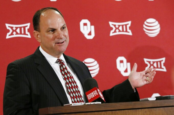 """FILE - In this Aug. 29, 2016, file photo, Oklahoma Athletic Director Joe Castiglione gestures as he answers a question during a news conference in Norman, Okla. Whether college football players play a lot in the fall, a little in the spring or not all over the next 10 moths, some athletic administrators want to give them a mulligan on the 2020-21 season. """"I think the most forgiving, flexible plan would be the best,"""" Oklahoma athletic director Joe Castiglione said. (AP Photo/Sue Ogrocki, File)"""