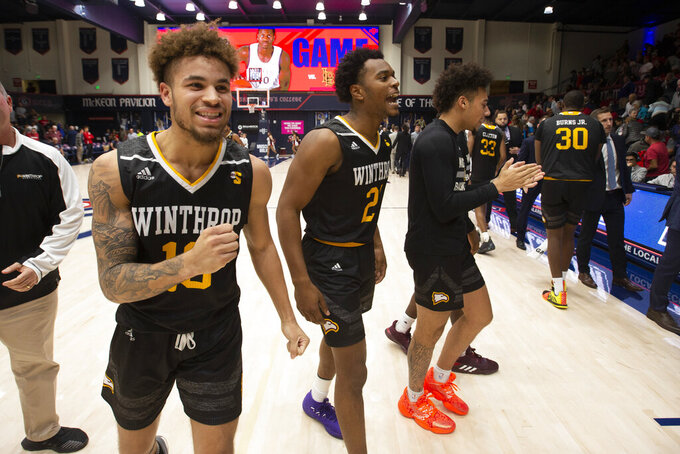 Winthrop guard Hunter Hale (13) and guard Jamal King (21) celebrate their team's victory over Saint Mary's an NCAA college basketball game, Monday, Nov. 11, 2019 in Moraga, Calif. Winthrop upset 18th-ranked Saint Mary's 61-59. (AP Photo/D. Ross Cameron)