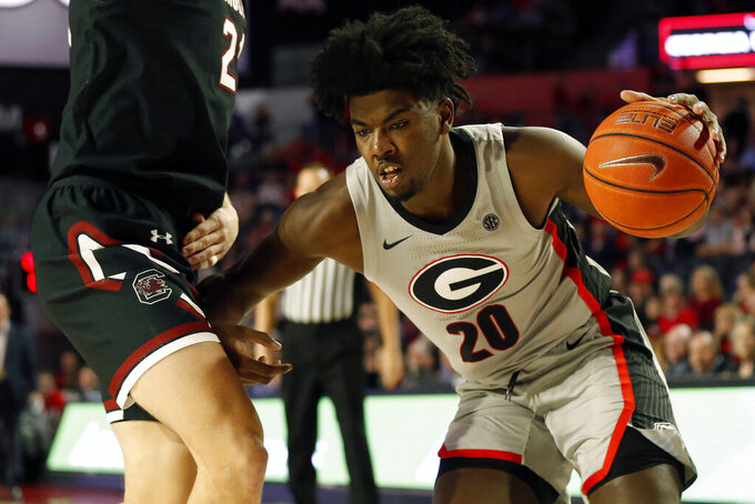 South Carolina forward Maik Kotsar (21) defends against Georgia's Rayshaun Hammonds (20)d uring an NCAA college basketball game Wednesday, Feb. 12, 2020, in Athens, Ga. (Joshua L. Jones/Athens Banner-Herald via AP)