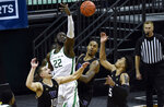 Washington guard Erik Stevenson (10), Oregon center Franck Kepnang (22), Washington forward Nate Roberts (1) and Washington guard Jamal Bey (5) try to corral the ball during the first half of an NCAA college basketball game Saturday, Feb. 6, 2021, in Eugene, Ore. (AP Photo/Andy Nelson)
