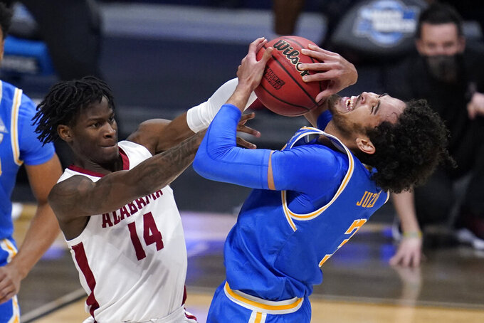 Alabama guard Keon Ellis (14) ties up UCLA guard Johnny Juzang (3) in the first half of a Sweet 16 game in the NCAA men's college basketball tournament at Hinkle Fieldhouse in Indianapolis, Sunday, March 28, 2021. (AP Photo/Michael Conroy)