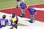 Kansas State head coach Chris Klieman pumps his fist while running off the field after his team's 38-35 win over the Oklahoma in an NCAA college football game, Saturday, Sept. 26, 2020, in Norman, Okla. (Ian Maule/Tulsa World via AP)