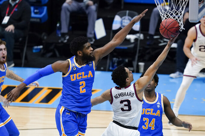 Gonzaga guard Andrew Nembhard (3) shoots ahead of UCLA forward Cody Riley (2) during the first half of a men's Final Four NCAA college basketball tournament semifinal game, Saturday, April 3, 2021, at Lucas Oil Stadium in Indianapolis. (AP Photo/Darron Cummings)