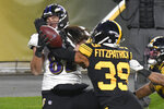 Pittsburgh Steelers free safety Minkah Fitzpatrick (39) breaks up a pass in the end zone to Baltimore Ravens tight end Luke Willson (82) as time runs out in first half of an NFL football game, Wednesday, Dec. 2, 2020, in Pittsburgh. (AP Photo/Don Wright)