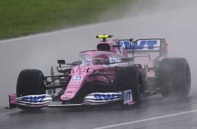 Racing Point driver Lance Stroll of Canada steers his car to win the pole position during the qualifying session at the Istanbul Park circuit racetrack in Istanbul, Saturday, Nov. 14, 2020. The Formula One Turkish Grand Prix will take place on Sunday.(Ozan Kose/Pool via AP)