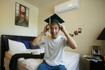 Sean Newsom, a senior at Paradise High School, tries out his graduation cap as he poses for a photo at the apartment he shares with his older brother Chico, Calif., Wednesday, June 5, 2019. After the Camp Fire destroyed the family home in Paradise, Calif., his parents relocated to the San Francisco Bay Area, and Newsom moved to an apartment with his older brother in Chico to finish his senior year. Newsom and the rest of the Paradise High School Class of 2019 are graduating Thursday. (AP Photo/Rich Pedroncelli)