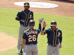 Oakland Athletics Matt Chapman (26) greets Robbie Grossman (8) and Marcus Semien (10) after Semien's two-run home run in the third against the Texas Rangers in a baseball game Sunday, Sept. 15, 2019, in Arlington, Texas. (AP Photo/Richard W. Rodriguez)