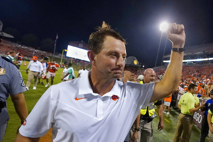 Clemson head coach Dabo Swinney pumps his fist to the crowd as he leaves the field after defeating Georgia Tech 14-8 in an NCAA college football game, Saturday, Sept. 18, 2021, in Clemson, S.C. (AP Photo/John Bazemore)