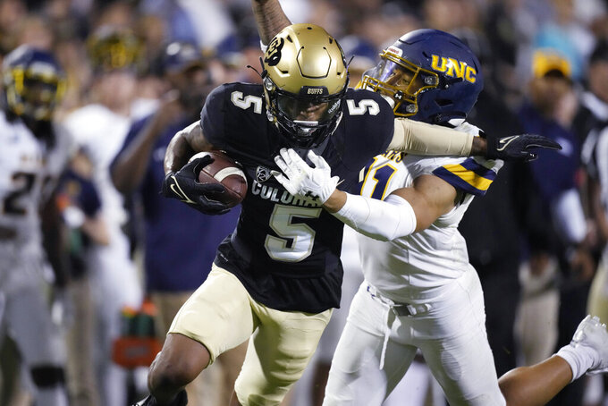 Colorado wide receiver La'Vontae Shenault is tackled by Northern Colorado linebacker Jace Bobo during the second half of an NCAA college football game Friday, Sept. 3, 2021, in Boulder, Colo. Colorado won 35-7. (AP Photo/David Zalubowski)