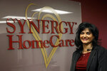 In this Feb. 20, 2020, photo Saili Gosula, executive director of SYNERGY HomeCare of San Mateo, poses for a photo at her office in San Mateo, Calif. Gosula has a remote administrative staffer and several onsite employees at her Synergy HomeCare franchise. (AP Photo/Jeff Chiu)