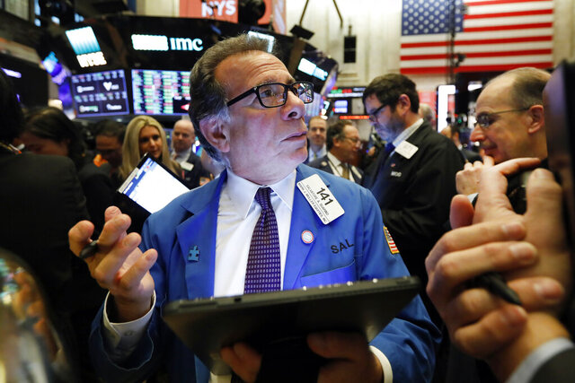 FILE - In this Dec. 13, 2019, file photo trader Sal Suarino works on the floor of the New York Stock Exchange. The U.S. stock market opens at 9:30 a.m. EST on Thursday, Dec. 19. (AP Photo/Richard Drew, File)