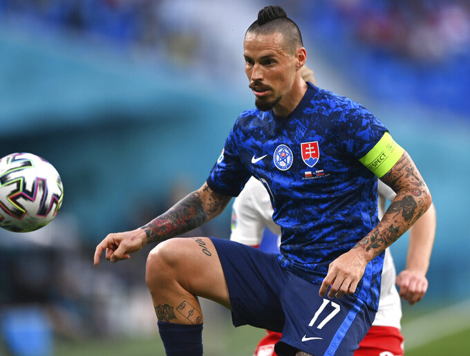 Slovakia's Marek Hamsik in action during the Euro 2020 soccer championship group E match between Poland and Slovakia at Gazprom arena stadium in St. Petersburg, Russia, Monday, June 14, 2021. (AP Photo/Kirill Kudryavtsev/Pool via AP)