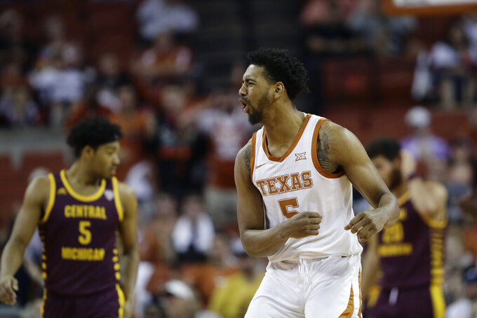 Texas forward Royce Hamm Jr., right, reacts to a call during the first half of an NCAA college basketball game against Central Michigan, Saturday, Dec. 14, 2019, in Austin, Texas. (AP Photo/Eric Gay)