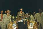 This image released by Disney Plus shows Beyonce Knowles, center, in a scene from her visual album
