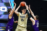 Purdue center Zach Edey, center, is trapped by Northwestern center Ryan Young, left, and forward Robbie Beran (31) during the first half of an NCAA college basketball game in West Lafayette, Ind., Saturday, Feb. 6, 2021. (AP Photo/Michael Conroy)