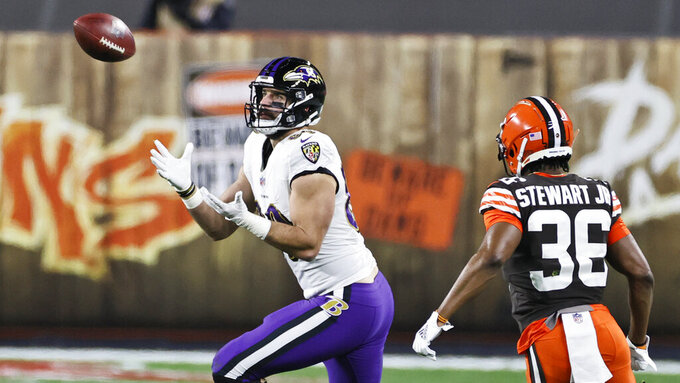 Baltimore Ravens tight end Mark Andrews (89) catches a pass as Cleveland Browns cornerback M.J. Stewart Jr. (36) defends during the first half of an NFL football game, Monday, Dec. 14, 2020, in Cleveland. (AP Photo/Ron Schwane)