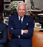FILE - In this Sept. 29, 2015 file photo, designer Ralph Lauren poses in his office in New York.  Lauren recently celebrated his label's 50th birthday, and a new HBO documentary,