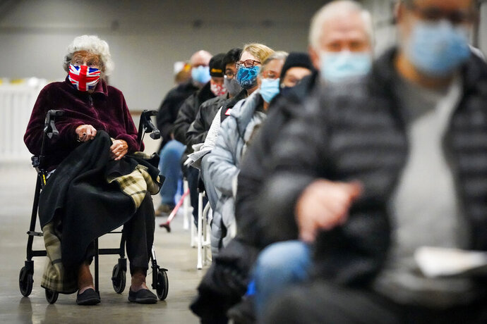 Georgette McGarrad, 99, (left) waits to receive the COVID-19 vaccine at Fair Park on Monday, Jan. 11, 2021, in Dallas. Dallas County launched its first