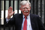 John Bolton, US National Security Advisor, arrives at Downing Street to meet Britain's Chancellor of the Exchequer Sajid Javid in London, Tuesday, Aug. 13, 2019. (AP Photo/Frank Augstein)