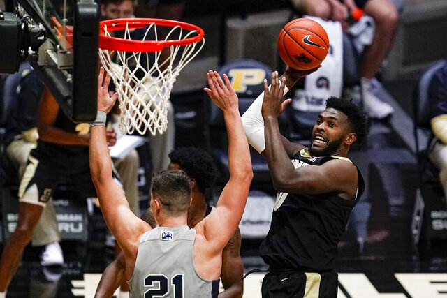 Purdue forward Trevion Williams, right, shoots over Penn State forward John Harrar (21) during the second half of an NCAA college basketball game in West Lafayette, Ind., Sunday, Jan. 17, 2021. (AP Photo/Michael Conroy)