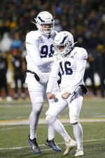 Georgia Southern's Tyler Bass (16) celebrates his 49-yard field goal with Anthony Beck II (98) during the first half of the team's NCAA college football game against Appalachian State on Thursday, Oct. 31, 2019, in Boone, N.C. (AP Photo/Brian Blanco)
