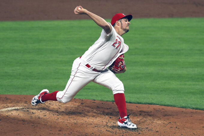 FILE - Cincinnati Reds' Trevor Bauer throws in the third inning during a baseball game against the Chicago White Sox in Cincinnati, in this Saturday, Sept. 19, 2020, file photo. Bauer is a free agent. (AP Photo/Aaron Doster, File)