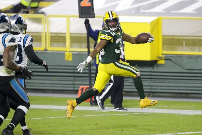 Green Bay Packers' Aaron Jones runs for a touchdown during the first half of an NFL football game against the Carolina Panthers Saturday, Dec. 19, 2020, in Green Bay, Wis. (AP Photo/Mike Roemer)