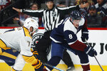 Colorado Avalanche defenseman Cale Makar, right, drives to the net past Nashville Predators defenseman Yannick Weber during the first period of an NHL hockey game Thursday, Nov. 7, 2019, in Denver. (AP Photo/David Zalubowski)