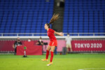 Canada's Julia Grosso celebrates after scoring the winning goal and defeating Sweden in a penalty shootout during the women's final soccer match at the 2020 Summer Olympics, Friday, Aug. 6, 2021, in Yokohama, Japan. (AP Photo/Andre Penner)