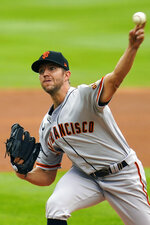San Francisco Giants starting pitcher Tyler Anderson throws against the Colorado Rockies during the first inning of a baseball game, Thursday, Aug. 6, 2020, in Denver. (AP Photo/Jack Dempsey)