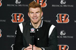 FILE - In this Dec. 29, 2019, file photo, Cincinnati Bengals quarterback Andy Dalton answers questions after his team defeated the Cleveland Browns in an NFL football game in Cincinnati. Dalton is coming home to Texas as Dak Prescott's backup with the Dallas Cowboys. Dalton and the Cowboys agreed to a one-year deal that guarantees the former Cincinnati starter $3 million and could be worth up to $7 million, two people with direct knowledge of the deal told The Associated Press on Saturday, May 2, 2020. (AP Photo/Gary Landers, File)