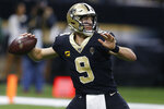 New Orleans Saints quarterback Drew Brees (9) looks to pass, during the second half at an NFL football game against the Carolina Panthers, Sunday, Nov. 24, 2019, in New Orleans. The Saints defeated the Panthers 34-31. (AP Photo/Butch Dill)