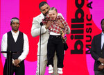 Drake carries his son Adonis Graham as he accepts the artist of the decade award at the Billboard Music Awards on Sunday, May 23, 2021, at the Microsoft Theater in Los Angeles. (AP Photo/Chris Pizzello)