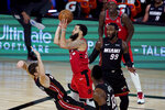 Toronto Raptors' Fred VanVleet (23) shoots as Miami Heat's Goran Dragic tries to draw the offensive foul during the second half of an NBA basketball game Monday, Aug. 3, 2020, in Lake Buena Vista, Fla. The Raptors won 107-103. (AP Photo/Ashley Landis, Pool)