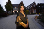"Alison Jones poses for a portrait outside her home in Rochester, Mich., Wednesday, Oct. 14, 2020. Trump's description of the suburbs seems to Jones like nostalgia for ""a `Leave it to Beaver' time"" when people who look like her could not have lived in her subdivision, where no house costs less than $1 million. (AP Photo/Paul Sancya)"