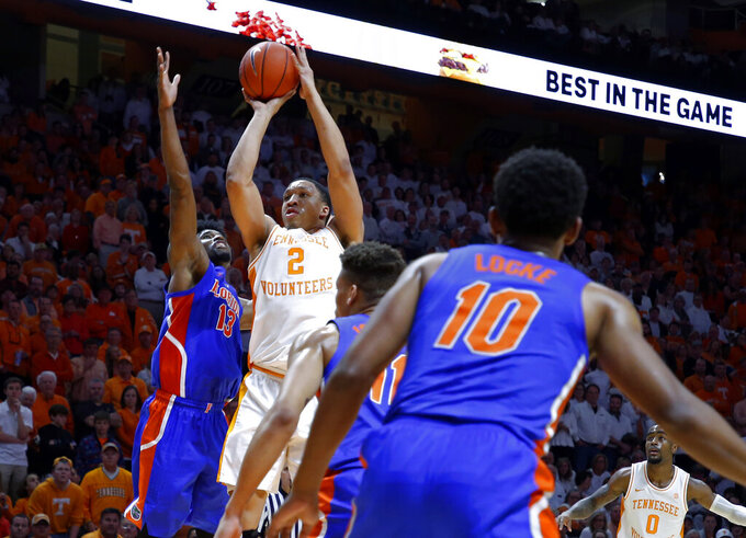 Tennessee forward Grant Williams (2) shoots as he's defended by Florida center Kevarrius Hayes (13) during the second half of an NCAA college basketball game Saturday, Feb. 9, 2019, in Knoxville, Tenn. Tennessee won 73-61. (AP photo/Wade Payne)