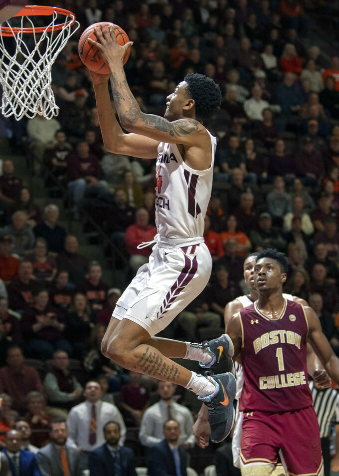 Virginia Tech guard Nickeil Alexander-Walker (4) goes up for a basket in front of Boston College forward Jarius Hamilton (1) during the second half of an NCAA college basketball game Saturday, Jan. 5, 2019, in Blacksburg, Va. Tech won 77-66. (AP Photo/Don Petersen)