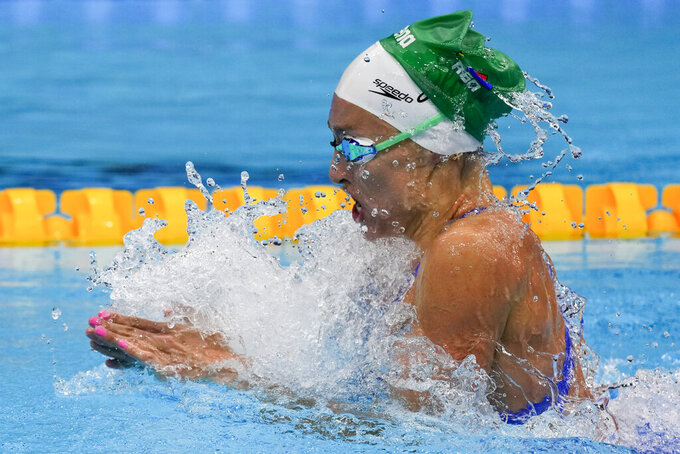 Tatjana Schoenmaker, of South Africa, swims in a heat during the women's 100-meter breaststroke at the 2020 Summer Olympics, Sunday, July 25, 2021, in Tokyo, Japan. (AP Photo/Charlie Riedel)