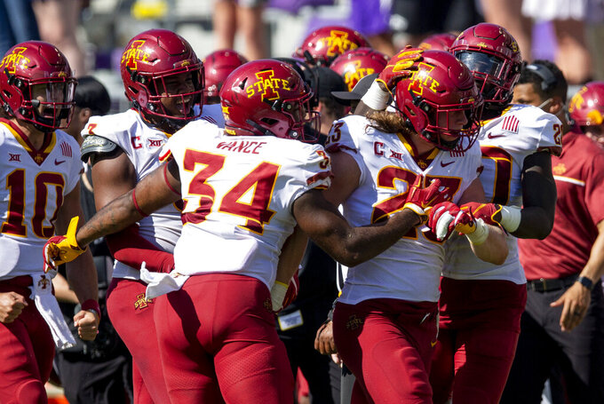 Iowa State linebacker Mike Rose (23) is congratulated by teammates after intercepting a TCU pass during an NCAA college football game on Saturday, Sept. 26, 2020 in Fort Worth, Texas. Iowa won 37-34. (AP Photo/Brandon Wade)