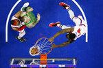 Philadelphia 76ers' Norvel Pelle, right, dunks the ball as Tobias Harris, left, and Boston Celtics' Daniel Theis look on during the second half of an NBA basketball game, Thursday, Jan. 9, 2020, in Philadelphia. (AP Photo/Matt Slocum)