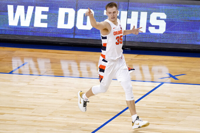 Syracuse guard Buddy Boeheim (35) reacts to a three point basket during the first half of an NCAA college basketball game against North Carolina State in the second round of the Atlantic Coast Conference tournament in Greensboro, N.C., Wednesday, March 10, 2021. (AP Photo/Gerry Broome)