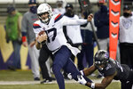 Arizona quarterback Grant Gunnell (17) is tripped by Washington's Dominique Hampton during the second half of an NCAA college football game Saturday, Nov. 21, 2020, in Seattle. Washington won 44-27. (AP Photo/Elaine Thompson)