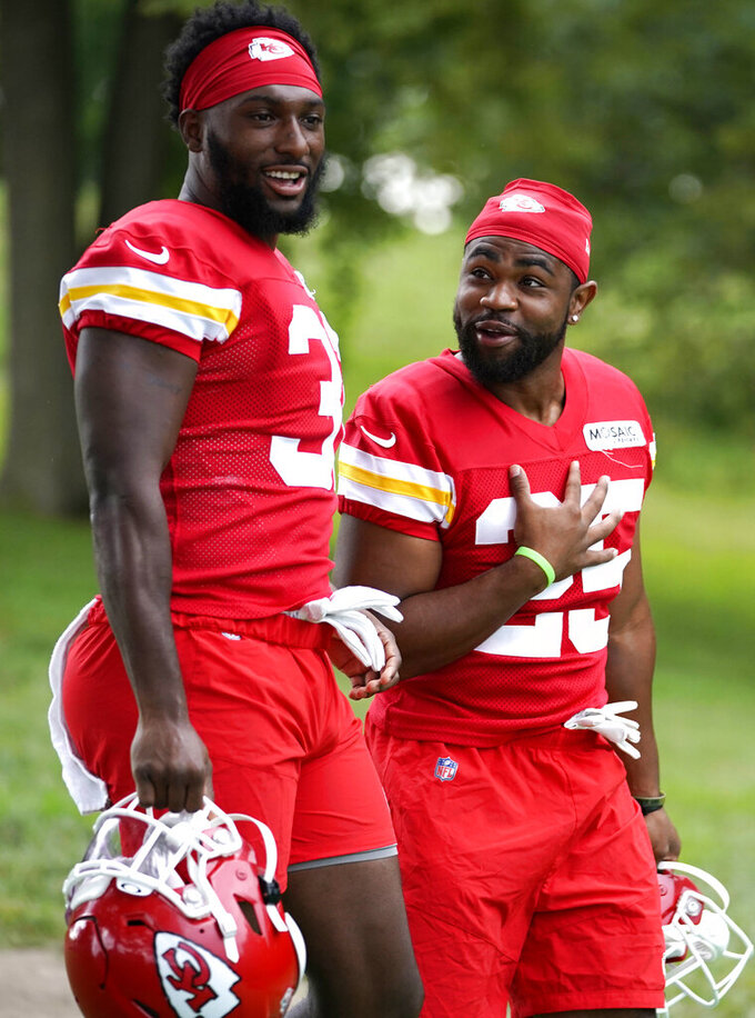 Kansas City Chiefs running back Darrel Williams, left, and Clyde Edwards-Helaire make their way to the field prior to the team's NFL football training camp Saturday, July 31, 2021, in St. Joseph, Mo. (AP Photo/Ed Zurga)